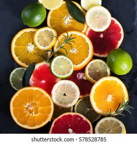 Sliced citrus fruits, vitamins, oranges, grapefruits, limes, juicy fruits background