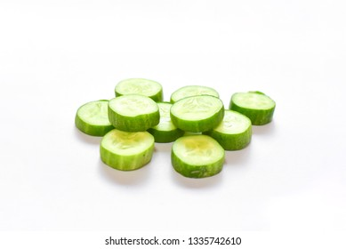 Sliced Cucumber Pieces on White Background