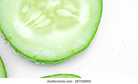 sliced cucumber in the water