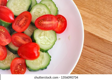 Sliced Cucumbers and Cherry Tomatoes. Close up.