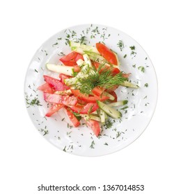 sliced cucumbers and tomatoes on a plate, isolated on white background. Top view