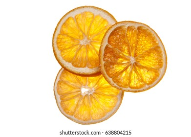 Sliced dried orange pieces against white background