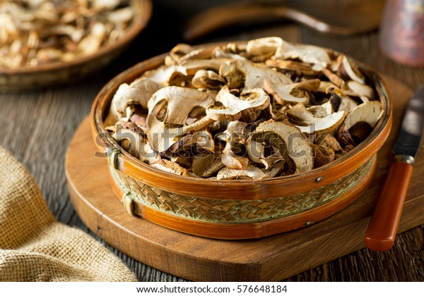 Sliced and dried wild mushrooms in a basket.