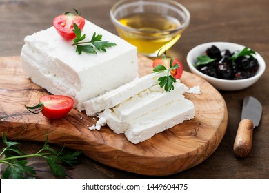 Sliced Feta cheese with herbs and olive oil.