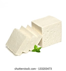 Sliced feta cheese with mint isolated on white background