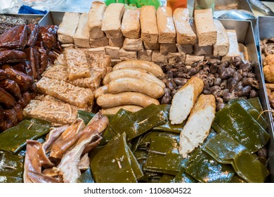 Sliced fish cake , pork sausages , tofu and offal selling on Feng Chia night market , street food market in  Taichung , Taiwan