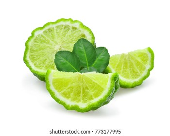 sliced fresh bergamot with green leaves isolated on white background