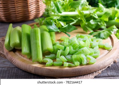 Sliced fresh celery on a cutting wooden board