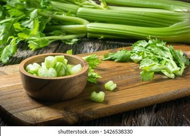 Sliced fresh celery or Celery stalk on cutting wooden board
