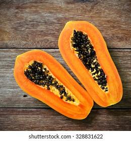 Sliced fresh papaya on wooden background