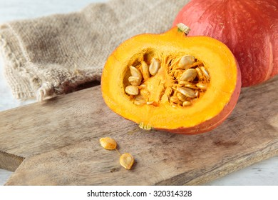 Sliced Fresh raw red kuri squash in autumn season