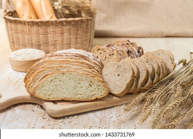 Sliced fresh rustic bread on a wooden. Kitchen or bakery poster design with seed.