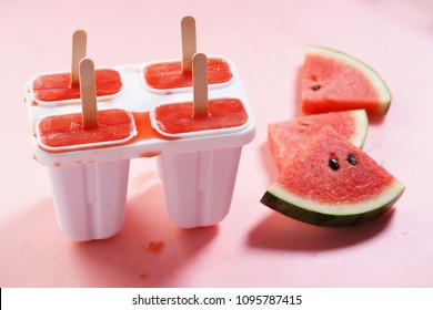 sliced fresh watermelon and red watermelon popsicles