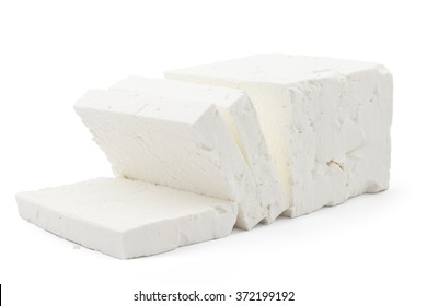 Sliced fresh white cheese from cow's milk on white background