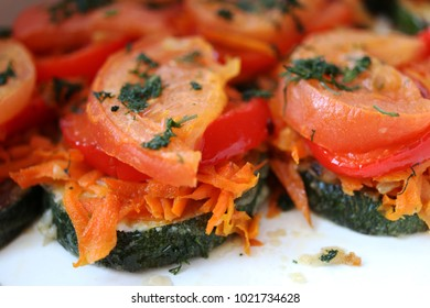 Sliced fried zucchini with onion, carrot, sweet pepper, tomatoes and greenery served in the Russian restaurant
