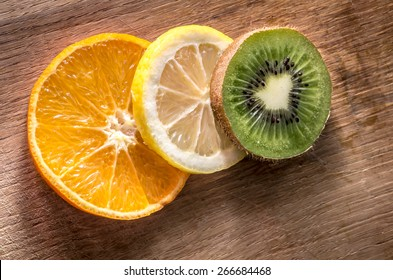 Sliced fruit on wooden board