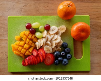 sliced-fruits-on-cutting-board-260nw-191