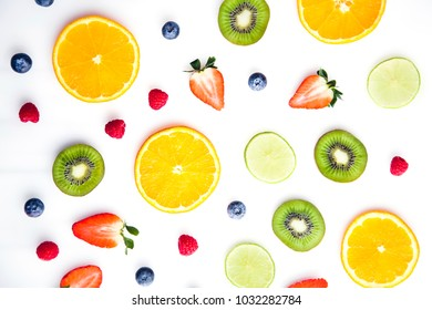 Sliced fruits on white background