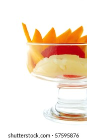 sliced fruits within transparent cup on white
