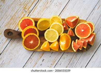 Sliced of frute.There are Cara cara Orange,Navel species,Lemon and Grapefruit put on wooden tray
