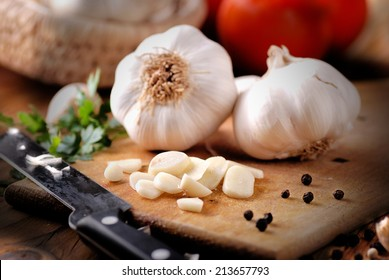 sliced garlic on wooden chopping board