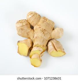 sliced ginger root on white background