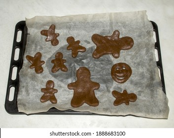 Sliced gingerbread dough with festive metal cutter on a flat flat surface, top view. Making holiday gingerbread, holiday advent.