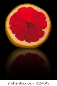 Sliced grapefruit isolated on black with reflection