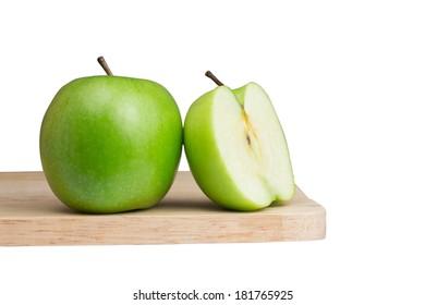 sliced green apple on the block