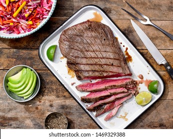 Sliced Grilled Flank Steak with avocado and cole slaw