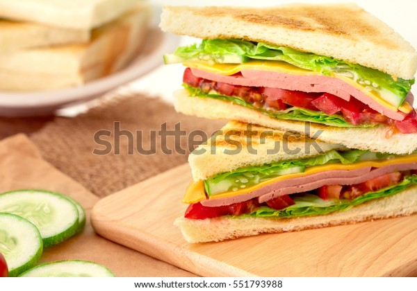 Sliced Grilled sandwiches bread with bacon , ham and cheese with vegetable , healthy breakfast