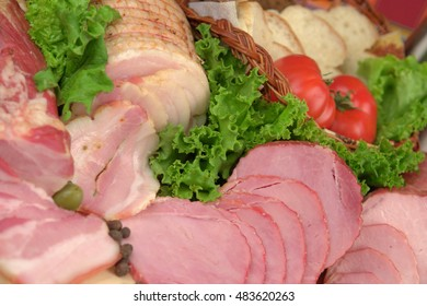 Sliced ham with greens and tomatoes