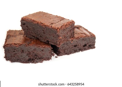 Sliced homemade brownies tower on white isolate background. Sweet and moist of chocolate dessert. With copy space.