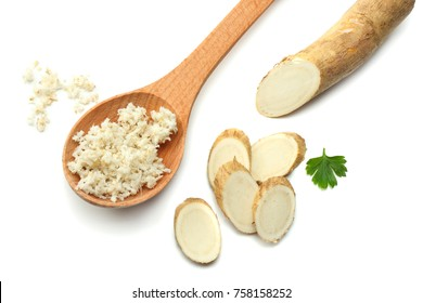 sliced horseradish root with parsley isolated on white background