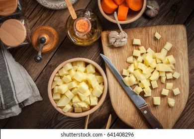 Sliced ingredients prepared to cook a tasty potato soup.