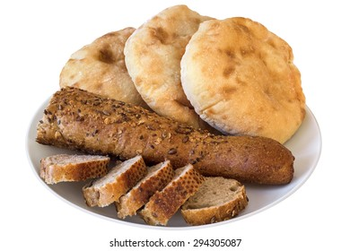 Sliced Integral Brown Baguette With Three Leavened Pitta Bread Loaves Offered On White Porcelain Plate Isolated On White Background