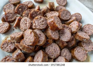 sliced Italian sausage pieces piled high