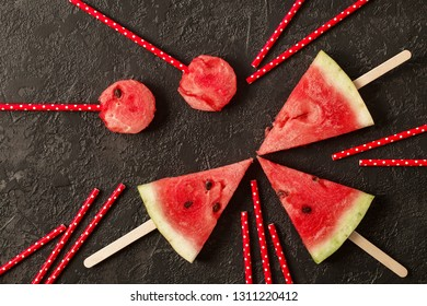 Sliced juicy watermelon on textured concrete background. Top view with copy space
