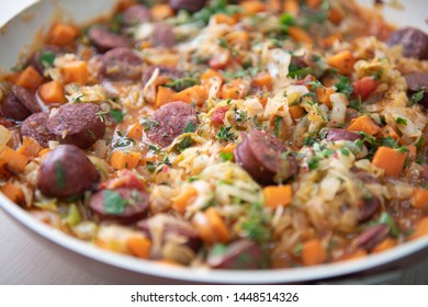 Sliced Kielbasa Sausage Cooked with Cabbage and other Vegetables
