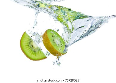 sliced kiwi fruit splashing isolated on white background