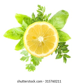 sliced lemon and green herbs on a white background