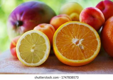 Sliced lemon and orange. Fruits on table