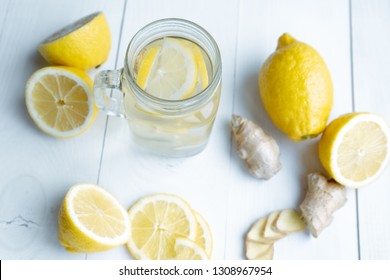 Sliced lemons and ginger root as drink ingridients