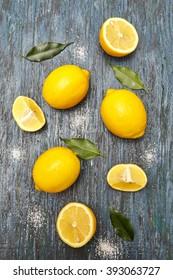 Sliced lemons. On the dark blue wooden background.
