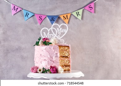 Sliced lesbian wedding cake on grunge background