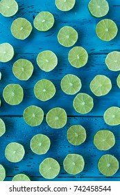 Sliced limes on a blue background