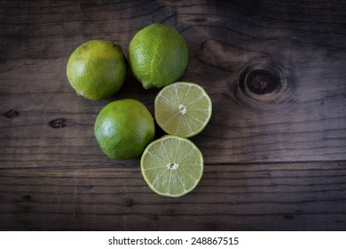 Sliced Limes on a wooden table