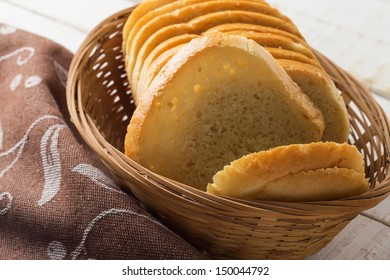 Sliced loaf of bread in bucket on wooden background. Selective focus.