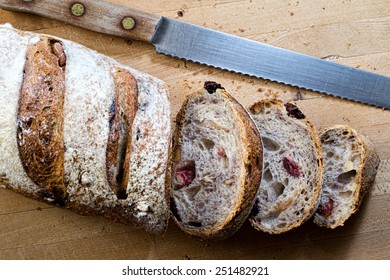 A sliced loaf of cranberry walnut bread