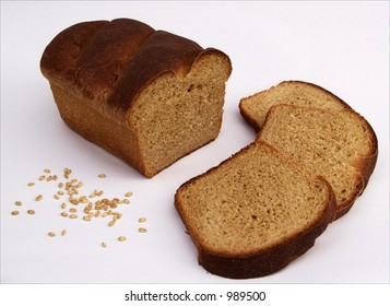 sliced loaf of homemade bread with whole wheat grains